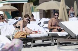 http://img182.imagevenue.com/loc78/th_312357918_Mischa_Barton_Bikini_Candids_on_the_Beach_in_Miami_December_27_2011_175_122_78lo.jpg
